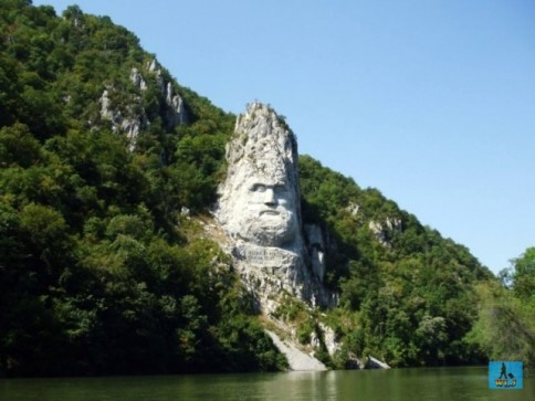Decebal's face sculpted into rock can be seen from a cruise on the Danube River, Mehedinti County